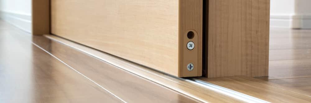 Close Up of a Pocket Door Floor Track
